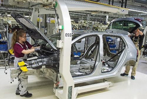 Volkswagen hits record sales in bid to top auto industry
