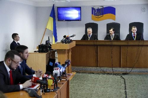 Ukrainian court sentences ex-president Yanukovych to 13 years in prison
