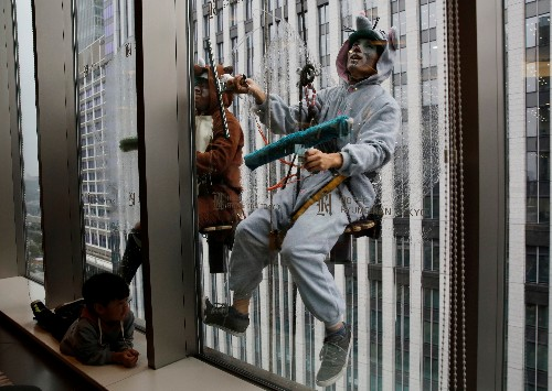 You dirty rat: Zodiac window cleaners set Tokyo sparkling for New Year