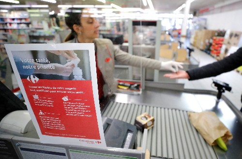 After death of a cashier, French supermarket staff work in fear