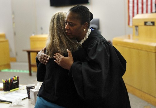 Ex-Dallas cop in deadly shooting gets hug from the judge