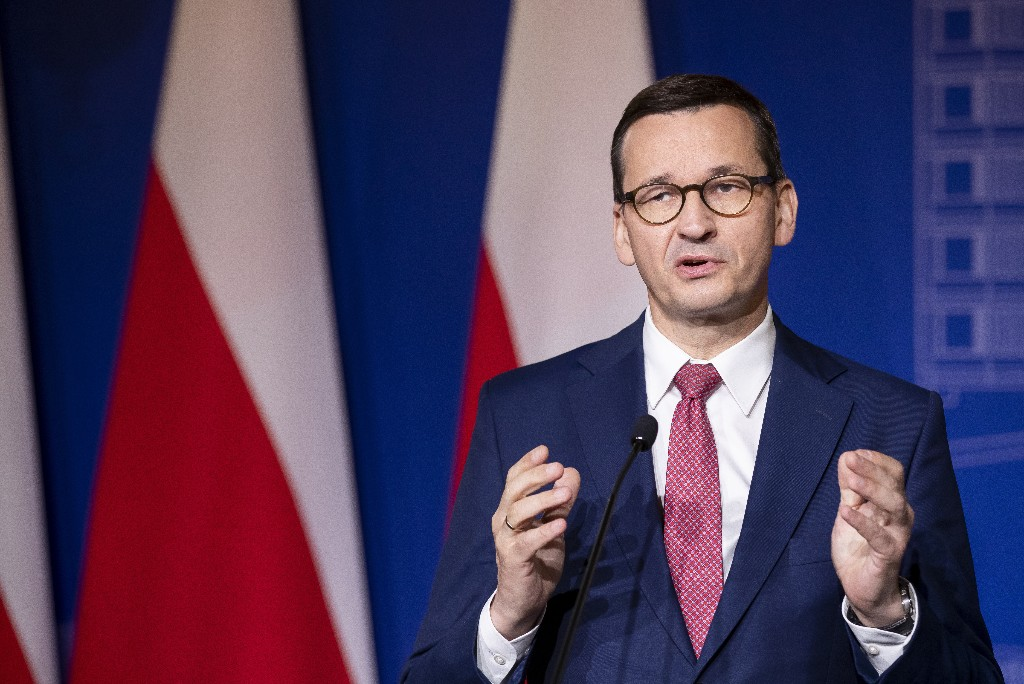 Polish ruling party forming minority govt, rejects partners