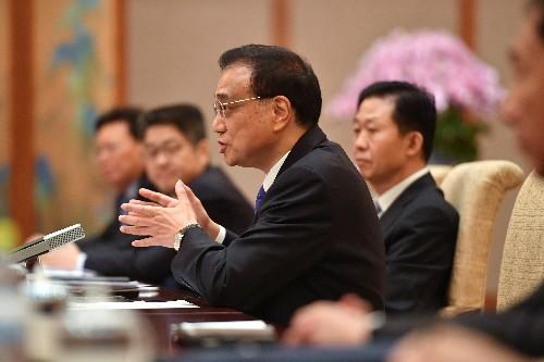 China's economy still faces downward pressure: premier