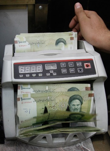 Iran merging military-linked banks to stabilize sector
