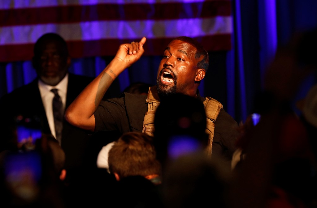 Kanye West assails music business in video showing man urinating on Grammy
