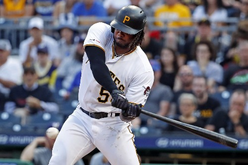 Bell caps historic month in style, Pirates top Brewers 9-4