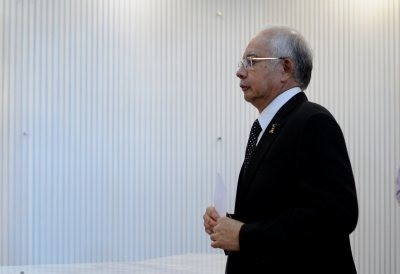 Malaysia 1MDB scandal: Foreign investors take fright as walls close in on PM Najib Razak