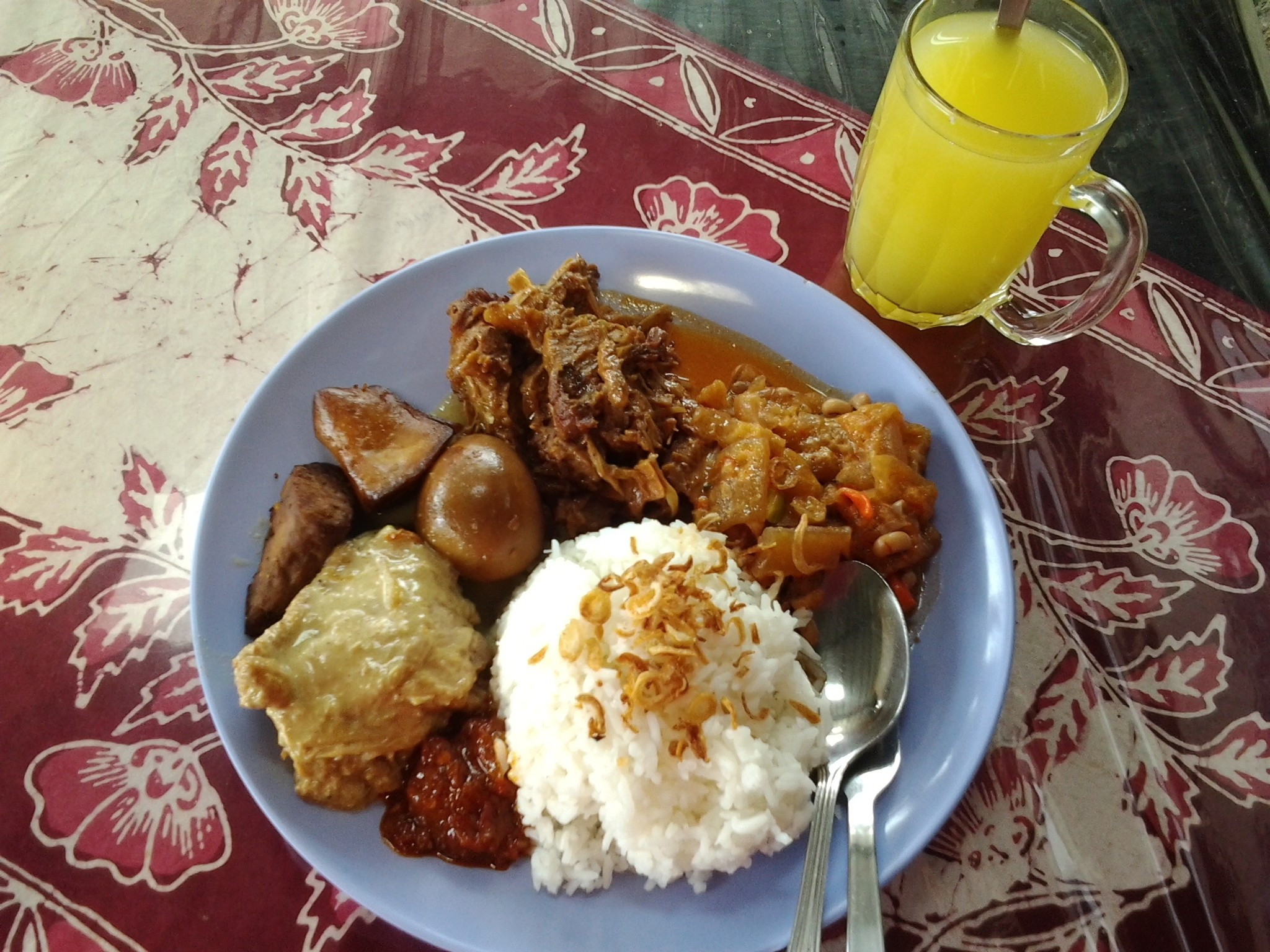 An authentic indonesian, it is called NASI GUDEG.if you wanted to know about the recipe, you click this Indonesianfood.com