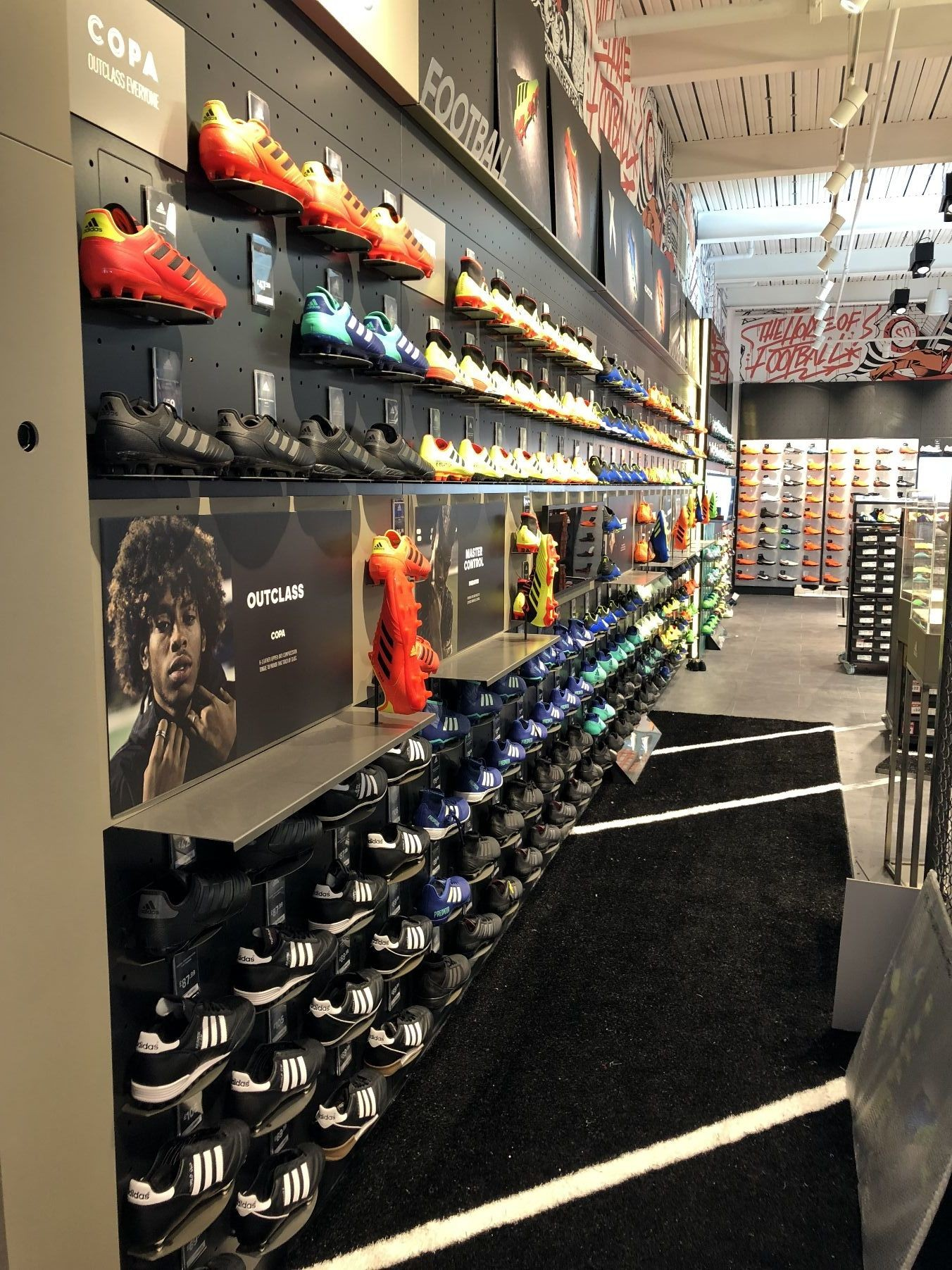 The black and white #ARTTRAGrass installation for a Sport shop chain..
