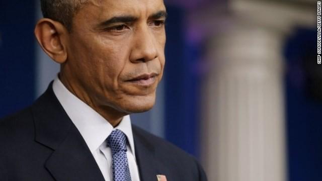 Judge orders halt to Obama immigration action