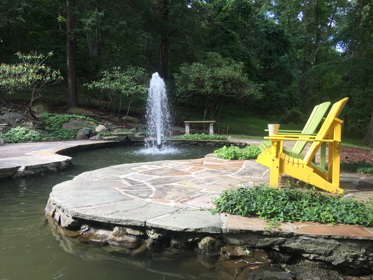 Formal style fountain in an antique garden pond in Greensburg Pennsylvania. Pond cleaned and serviced, and fountain installed by Aquatic Edge
