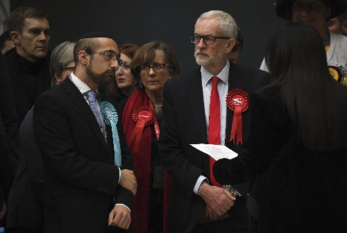 The Latest: UK election a disaster for Labour chief Corbyn