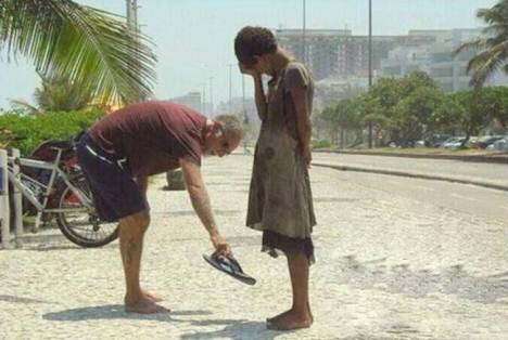 Task 2: Random acts of kindness: I chose this image because it really showed how this particular person went out of his way just to help a stranger and give him shoes and this really showed how much a pear of shoes meant to him and the joy and relieve from all the pain his feet have gone through
