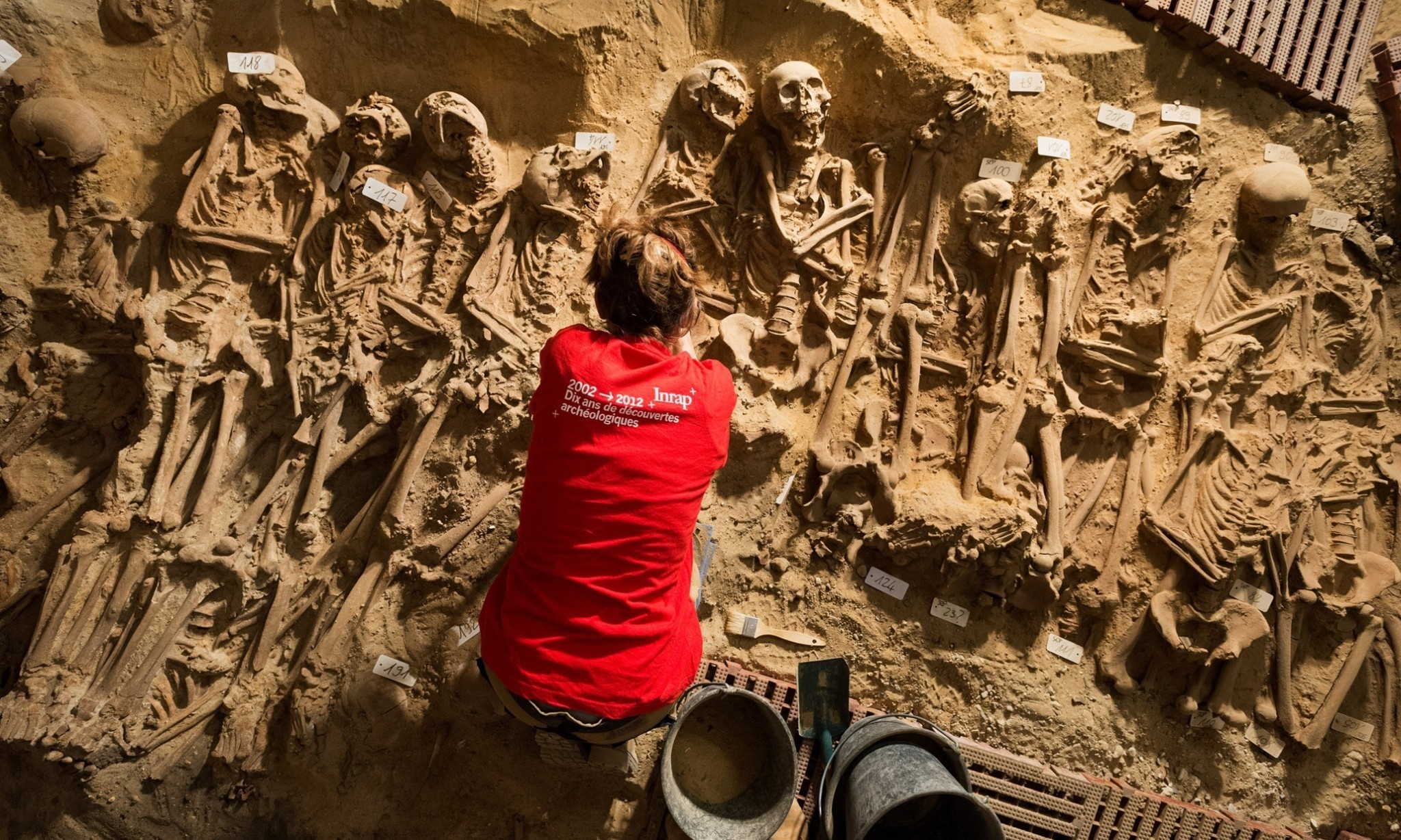 Parisians carry on shopping as mass graves are exhumed below their feet