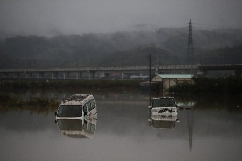 Japan looks for missing after typhoon kills dozens