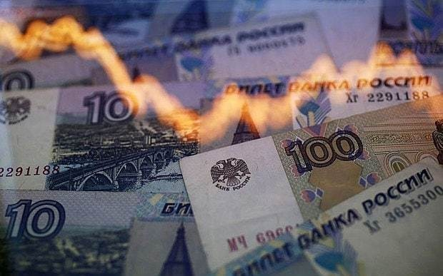 Capital controls feared as Russian rouble collapses