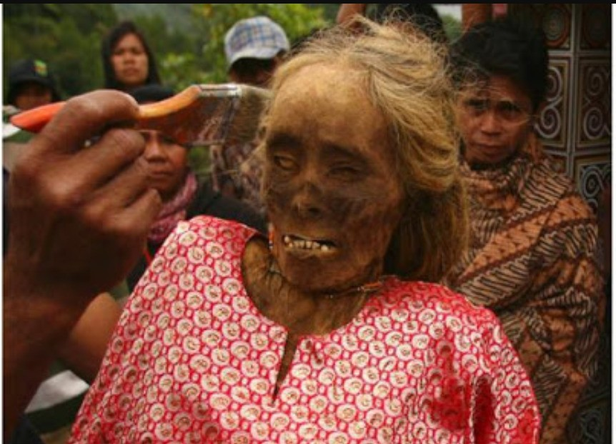 make up for the dead man in toraja. after burrying those who were dead will be made up like animate people.it is really amazing and mistic moment