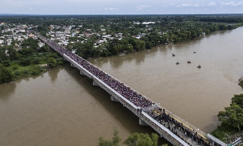 Migrant Caravan Trying to Enter Mexico: Pictures