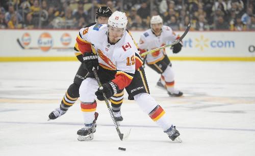 Flames hold off Penguins, snap 4-game skid