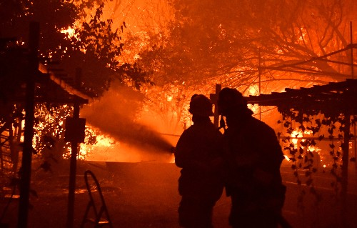 Deadly Los Angeles wildfire began near base of electrical tower, company and fire officials say