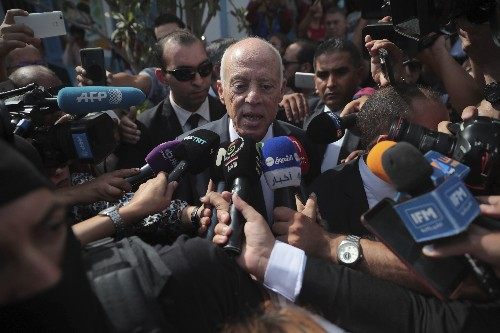 The Latest: Tunisia projections say professor wins election