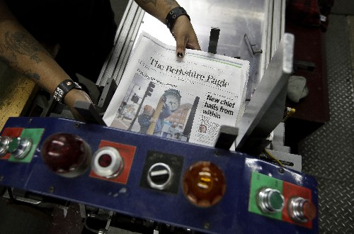 A newspaper bucks layoff trend, and hopes readers respond