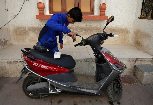 India asks scooter, bike makers to draw up plan for EVs: sources