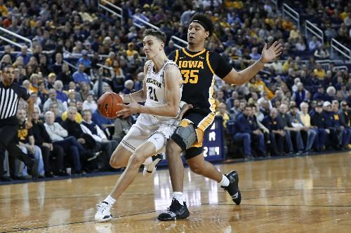 No. 4 Michigan tops Iowa 103-91 despite 44 points from Garza