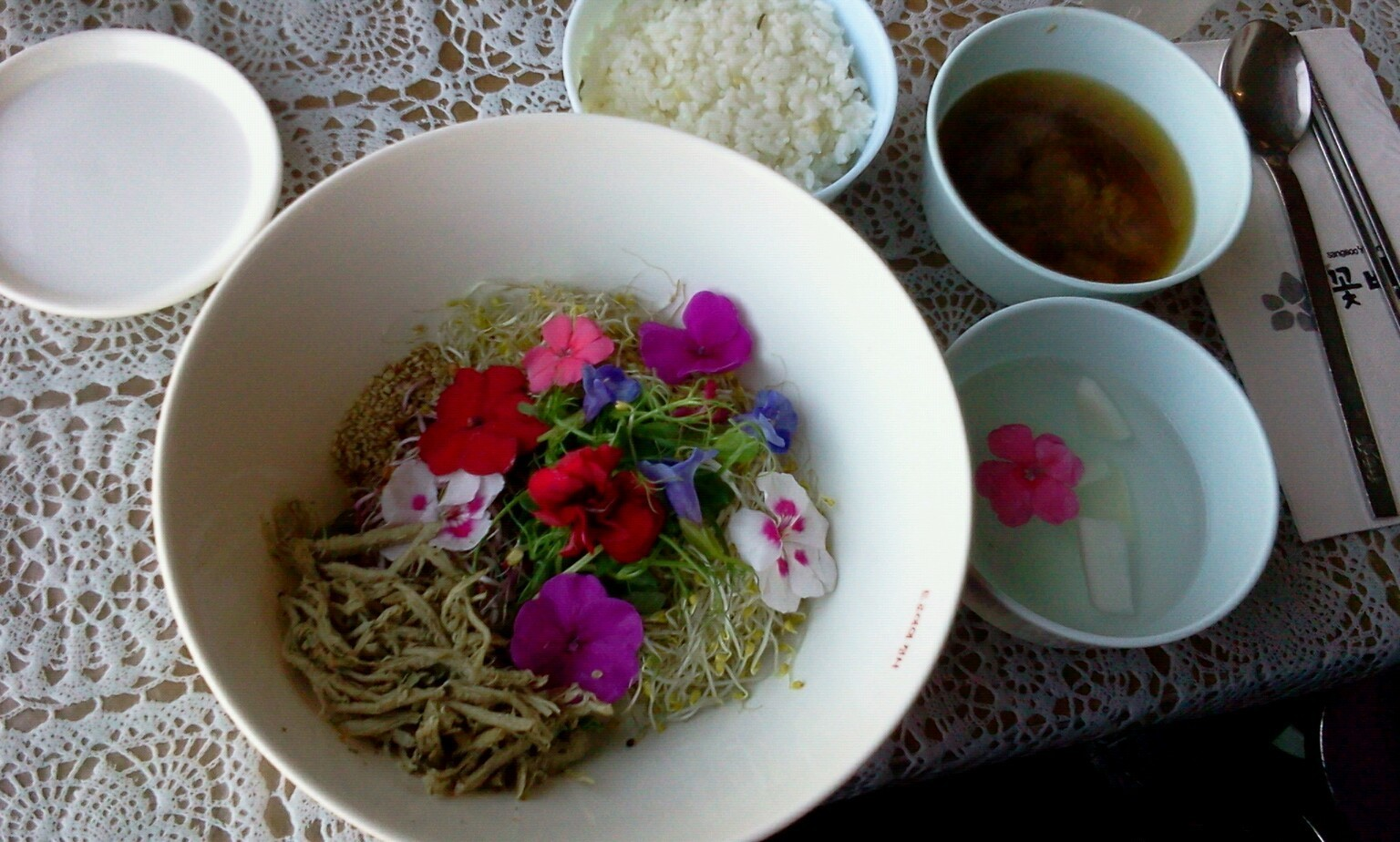 Cot bab ( flower rice ) this is my first time eating cot bab, here in South korea..taste is really good for me, this kind of food is so amazing and really good for our health; the fowers is from the herbs plants..��