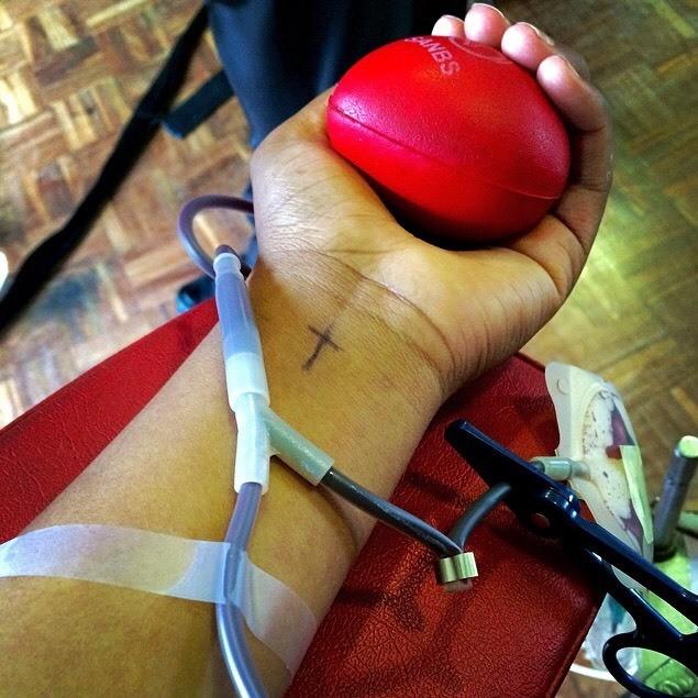 Girls donating blood at school.