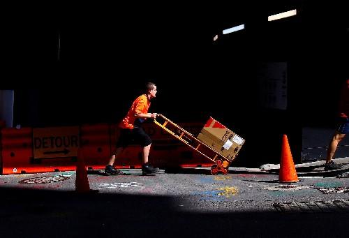 Australia jobs surge past expectations but unemployment ticks up