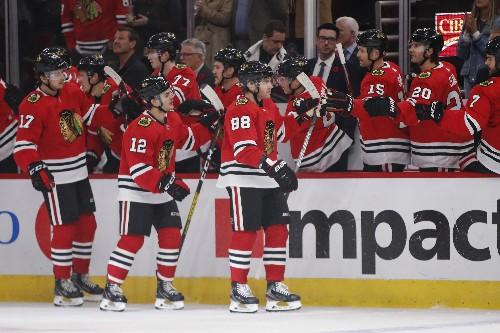 Kane, Blackhawks jump on Leafs, hang on for win