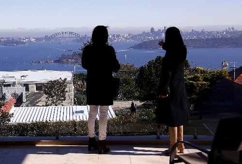 Australia cuts annual immigrant cap, puts key cities off-limits to some