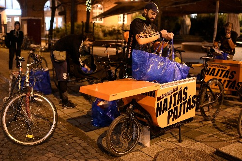 Budapest bikers hand out sandwiches and hope for Christmas