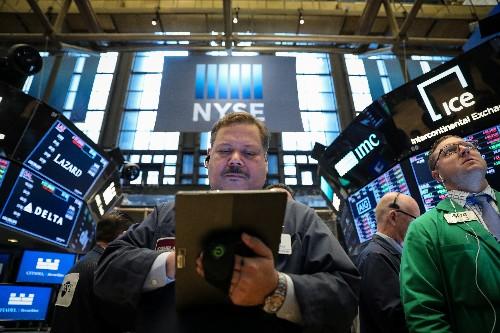 Wall Street finit sans entrain malgré un record pour le Nasdaq