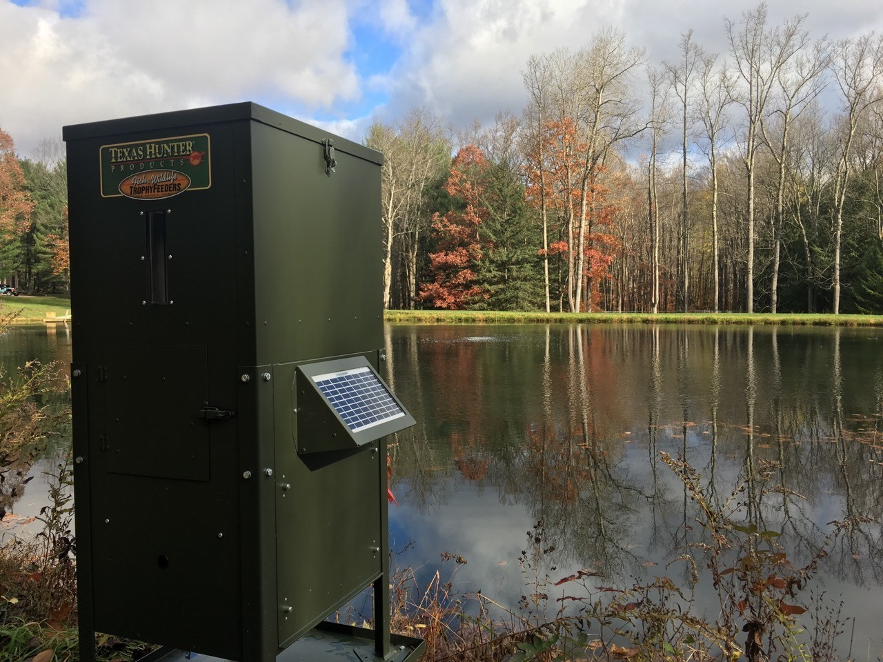 Texas Hunter brand fish and wildlife feeders are available in a wide range of sizes and styles. This fish feeder is installed on a private lake in Ligonier Pennsylvania.