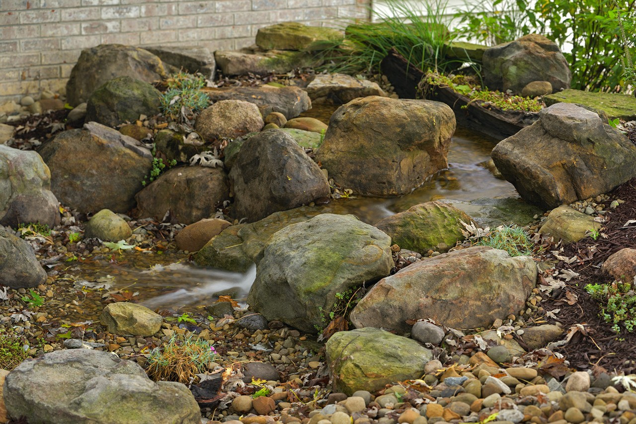 Small backyard pondless waterfall in Latrobe PA built by Aquatic Edge