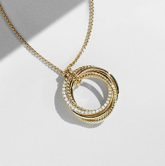 Around and around we glow. Stunning David Yurman Crossover Necklace in 18K gold.