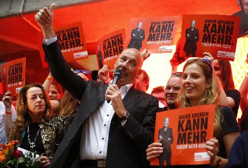 German state vote could threaten future of Merkel coalition