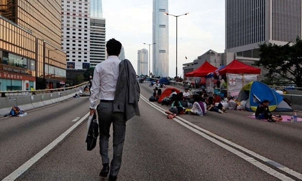 Hong Kong protests: civil servants allowed to return to work but activists remain
