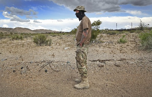 Authorities keep distance, yet work with armed border group