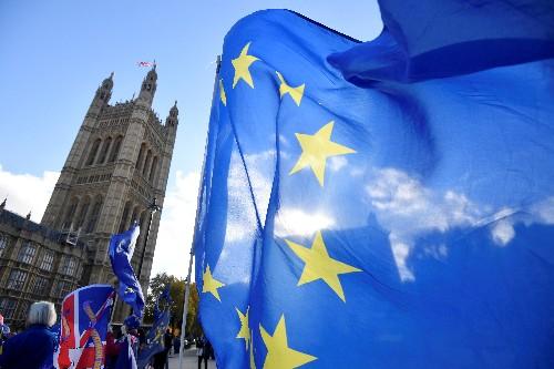 英EU、離脱合意草案で合意 強硬派は反発