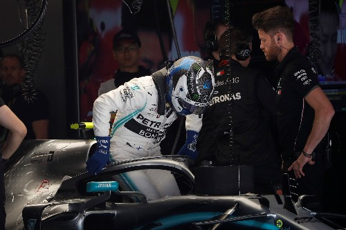 Motor racing: Mercedes wary of Ferrari threat despite front row lockout