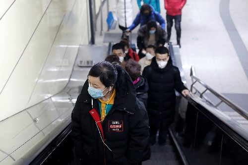 China county offers reward for identifying people from virus-hit Wuhan