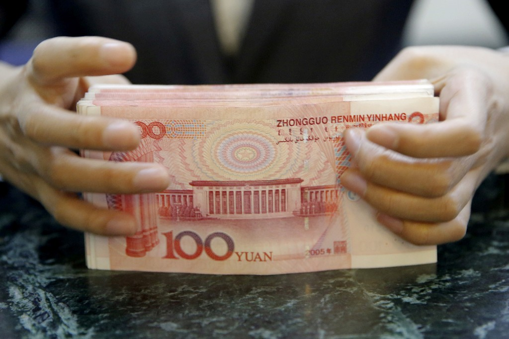 Exclusive: China asks banks to suspend counter-cyclical factor in yuan fixing - sources