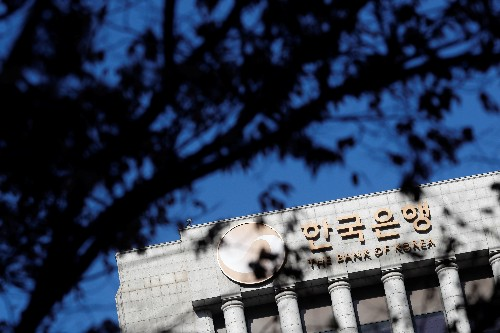 South Korea central bank surprises with rate cut, likely to loosen again