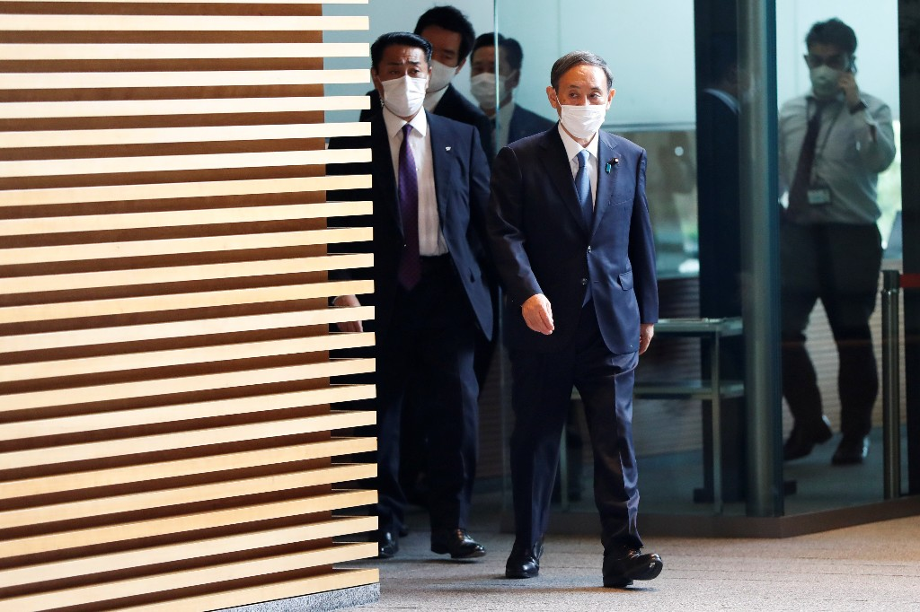 New cabinet, same faces: Japan's new PM Suga keeps key ministers