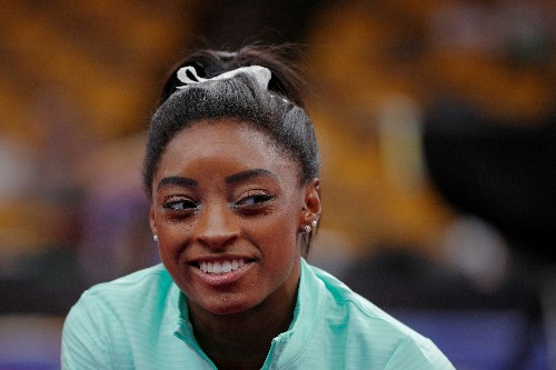 U.S. team heading in positive direction from dark place, says Biles