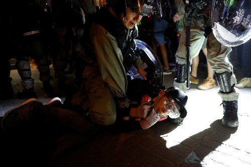 Hong Kong protests met with tear gas; China frees UK mission staffer