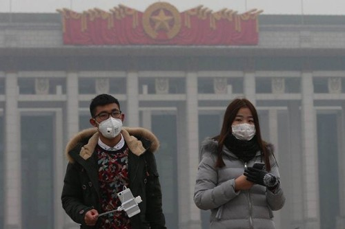 Beijing's first-ever smog 'red alert', in pictures - Telegraph